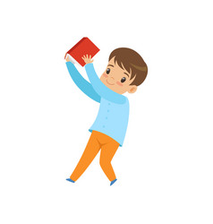 cute liitle boy with book kid playing and vector image