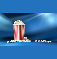 red and white cardboard bucket with popcorn vector image