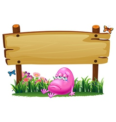 A sad pink monster under the empty signboard vector image