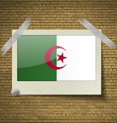 Flags Algeria at frame on a brick background vector