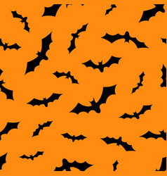 Set of bats silhouettes flying isolated on orange vector
