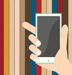smartphone on hand on plank wood background vector image