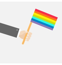 Businessman hand holding rainbow gay pride flag vector image vector image