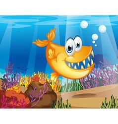 An orange fish near the coral reefs vector