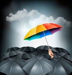 One rainbow umbrella standing out on a grey vector