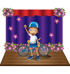 A boy and his bike at the center of the stage vector image