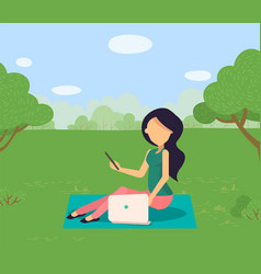 Woman sitting on grass in park with laptop vector