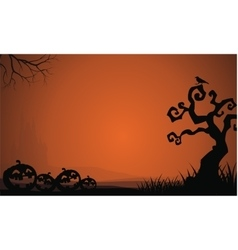 Silhouette of Halloween pumpkins and dry tree vector