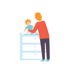 Father dressing his toddler baby on changing table vector