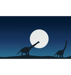 At night argentinosaurus landscape of silhouettes vector image