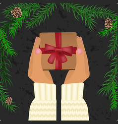 hands holding christmas gift vector image