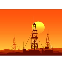 Oil and gas rigs over orange desert sunset vector