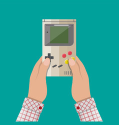 Old gadget handheld game console in hands vector