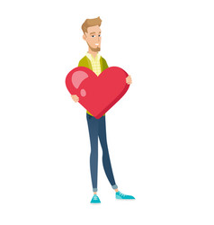 caucasian businessman holding a big red heart vector image