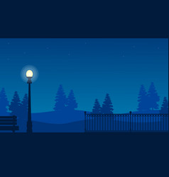Silhouette of fence on garden with street lamp vector
