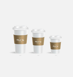 3 white coffee cups mockup with brown holder vector
