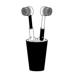 glass with two electric toothbrush in black vector image