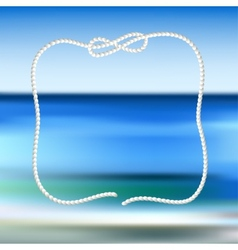 White rope frame on a blue sea blurred background vector image vector image