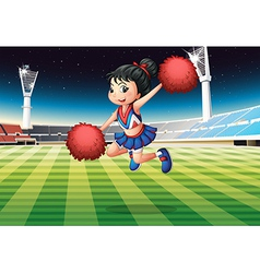 A cheerleader performing at the stadium vector image