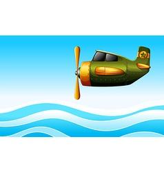A green plane above the ocean vector