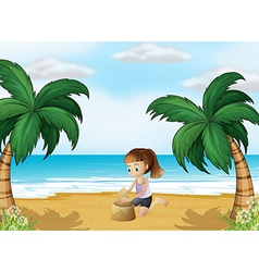 A young girl forming a sand castle at the beach vector image vector image