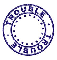 Grunge textured trouble round stamp seal vector