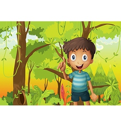 A forest with young boy wearing stripe tshirt vector