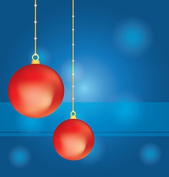 Red Christmas balls on abstract blue background vector