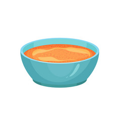 Curry or spicy orange sauce in bright blue ceramic vector