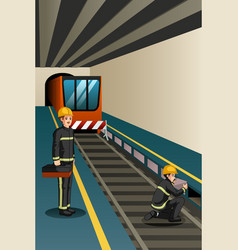 Subway workers working on rails vector