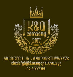 Golden letters and numbers with initial emblem in vector