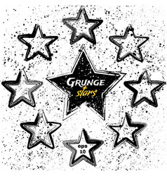 Set of black grunge stars vector