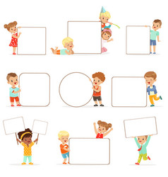 smiling kids standing with white blank boards set vector image