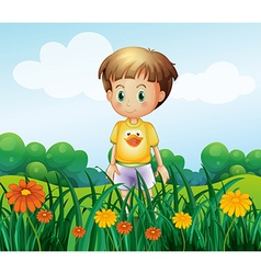 A young boy in front of the garden at the hilltop vector