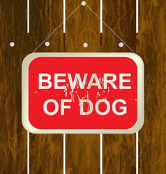 Beware of a dog sign on a wooden fence vector