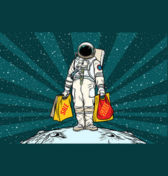 Lone retro astronaut with a sale shopping bags vector