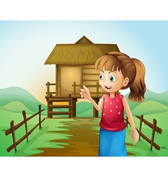 A woman in front of the nipa hut in the farm vector image