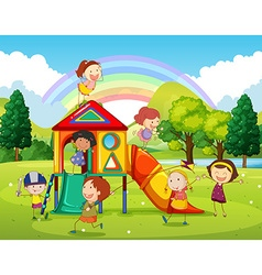 Children playing at the playground in the park vector image