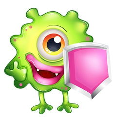 A green monster holding a shield vector image vector image