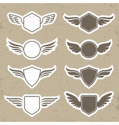 Vintage heraldic shapes with wings vector