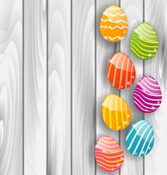 easter glossy colorful eggs on grey wooden texture vector image