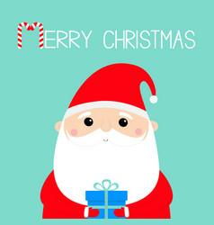 merry christmas santa claus holding gift box vector image