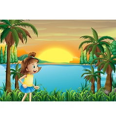 A young girl playing near the river vector