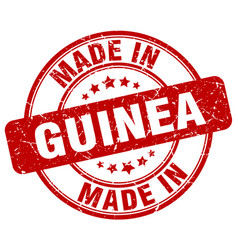 made in guinea red grunge round stamp vector image