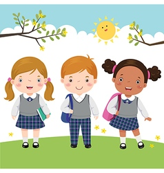 Three kids in school uniform going to school vector image vector image