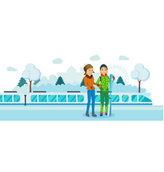 two friends with skis at railway winter station vector image