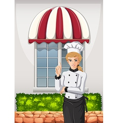 A chef in front of the restaurant vector