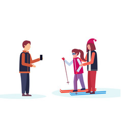 man taking photo skiers couple winter vacation vector image