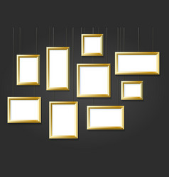 golden photo picture frames on black wall vector image