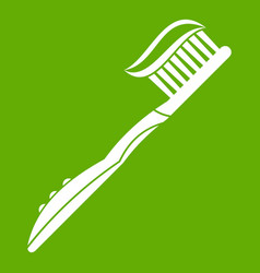 toothbrush with toothpaste icon green vector image